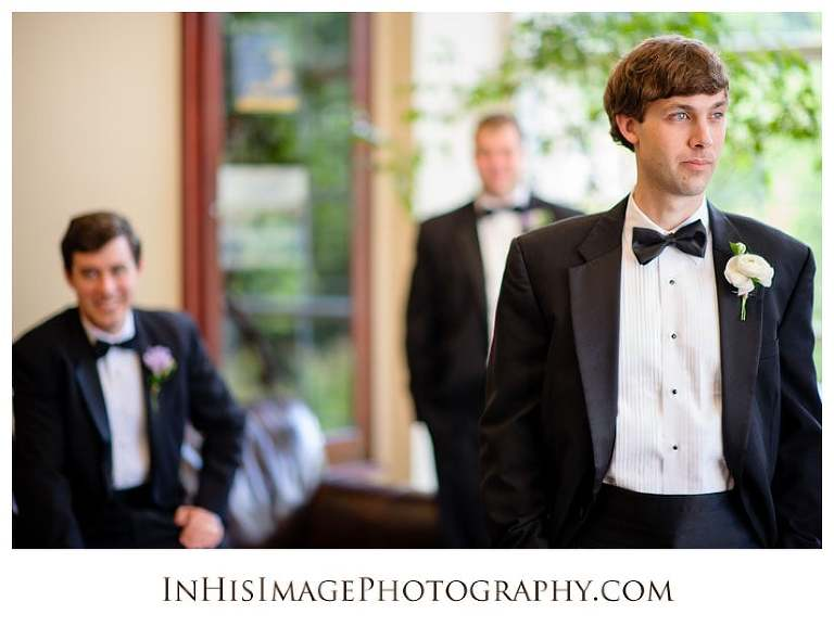Groom reflecting prior to wedding ceremony