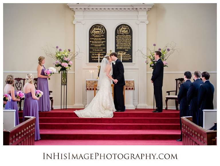Groom kissing his bride during ceremony at Saint David's School wedding